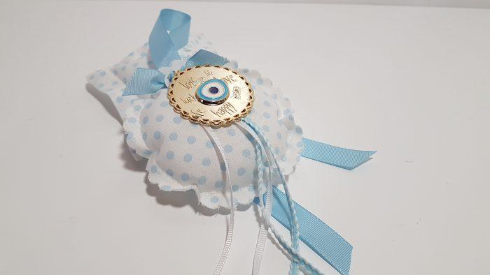 Φουσκωτό μαξιλαράκι στρογγυλό σιέλ πουά και μεταλλικό κύκλο με ευχές και μάτι.
