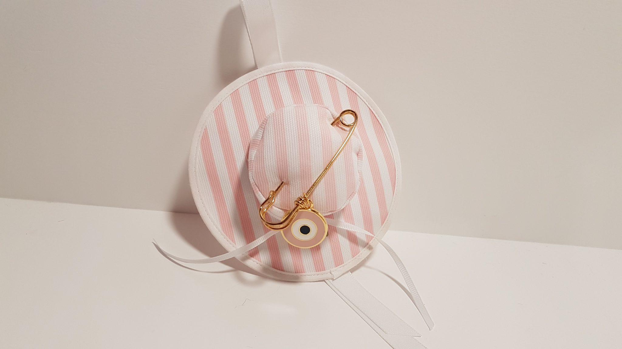 Καπελάκι φουσκωτό ροζ πουά με παραμάνα και μεγάλο μάτι χρυσό.