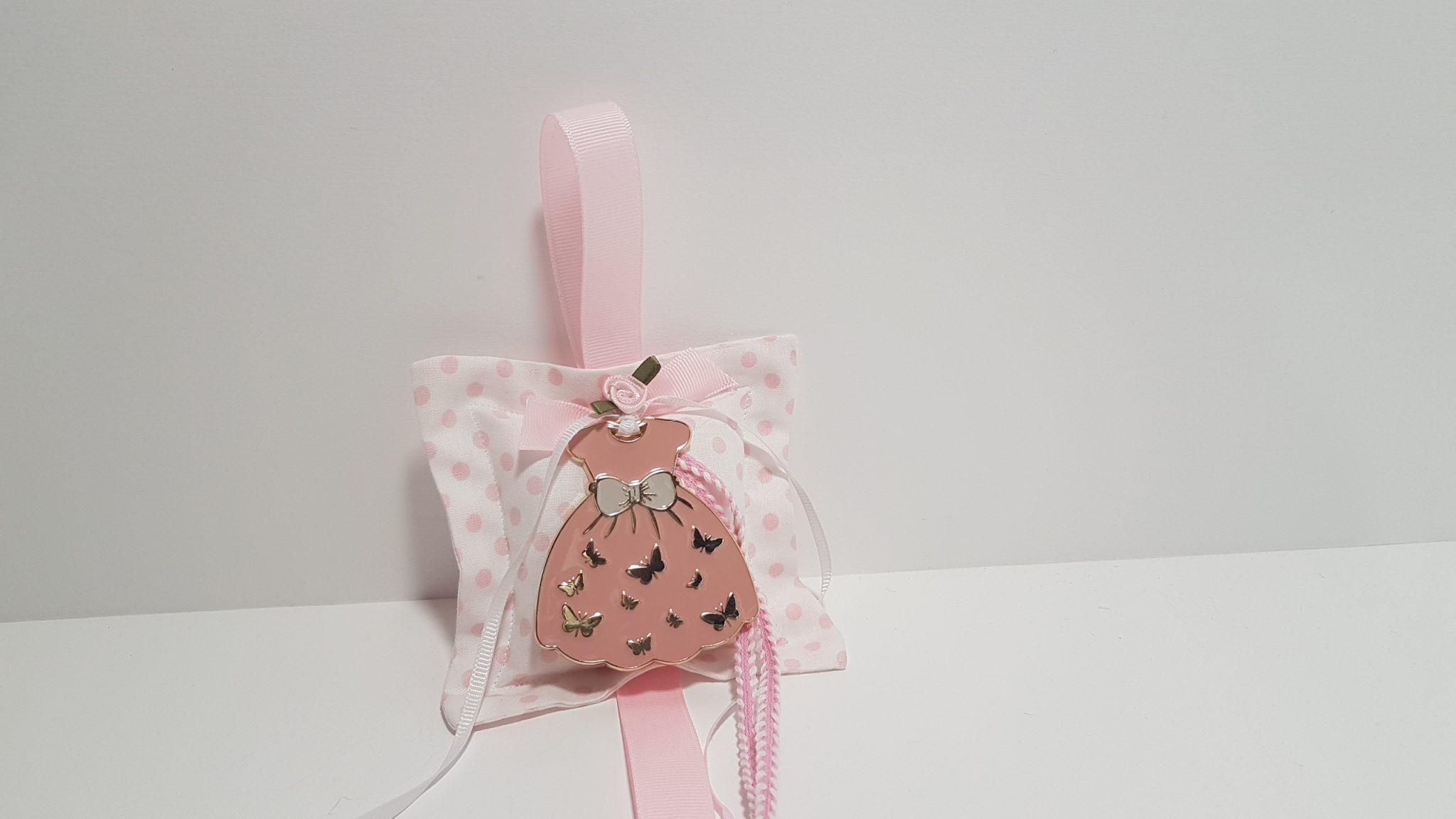 Φουσκωτό μαξιλαράκι πουά με μεταλλικό χρυσό φορεματάκι ροζ.